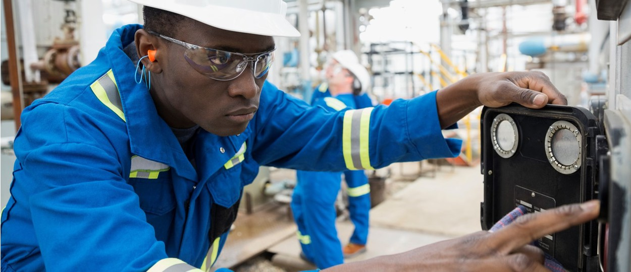 Man working at gas plant photo